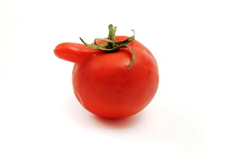 Deformed tomato on a white background Stock Photo