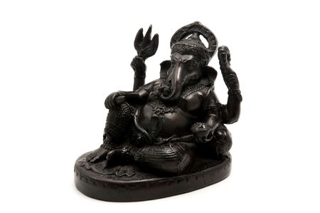 Statue of the hinduist god Ganesha on a white background  photo