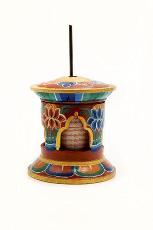 Prayer wheel on a white background photo