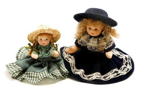 Old porcelain dolls on a white background