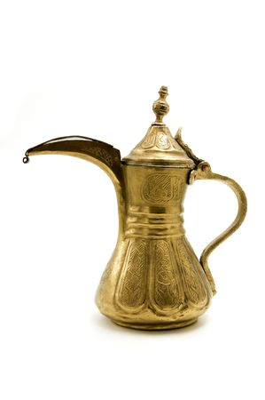 Antique arab teapot on a white background photo
