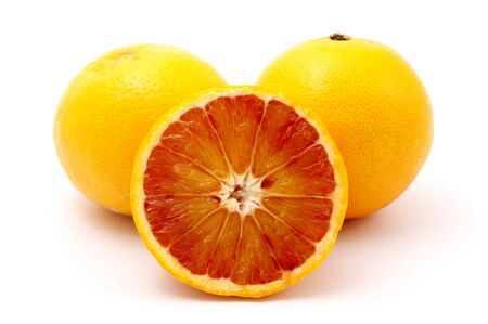 valencia orange: Blood oranges on a white background Stock Photo