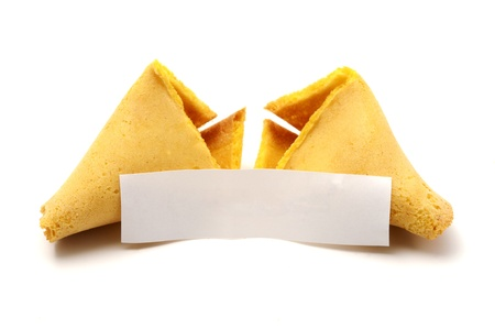 Broken fortune cookie with blank copyspace on a white background photo