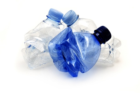 Plastic bottles ready for recycling on a white background