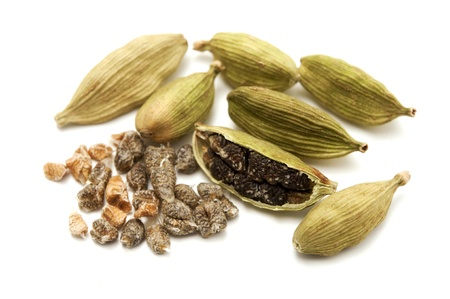 Green cardamom on a white background photo
