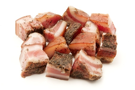 Italian guanciale cubes on a white background Stok Fotoğraf