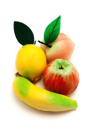 marzipan: Frutta martorana (traditional sicialian fruit shaped marzipan pastry) on a white background Stock Photo