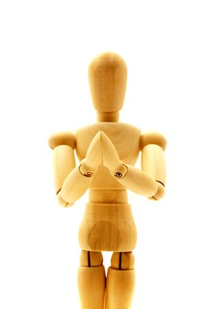 wooden mannequin: Praying mannequin on a white background