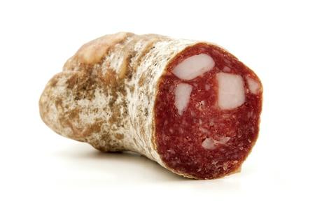salame: Corallina romana (traditional roman salami mixed with pieces of lard) on a white background Stock Photo