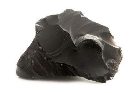 igneous: Raw obsidian on a white background Stock Photo