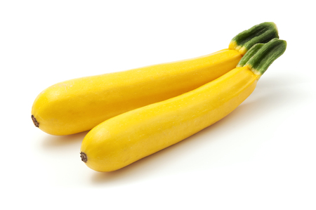 Golden zucchini on a white background