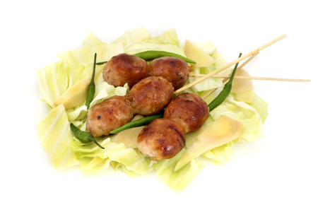 northeastern: Sai krok Isan (a fermented sausage originating in the northeastern provinces of Thailand) on a white background