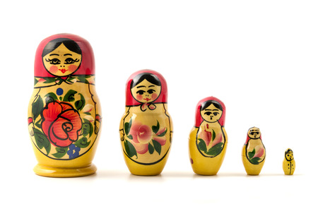 Matryoshka doll (little matron) on a white background  Imagens