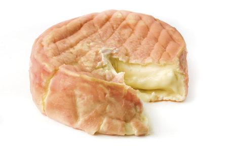 Epoisses de Bourgogne cheese on a white background