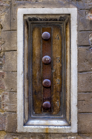 Old mechanical doorbell in Siena, Italy