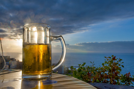 Beer at sunset viewing the ocean, Puerto de la Cruz, Tenerife, Canary Islands Stock Photo