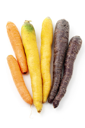 Mixed carrots on a white background