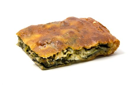 Typical Borek with a spinach and cheese filling on a white background Stock Photo