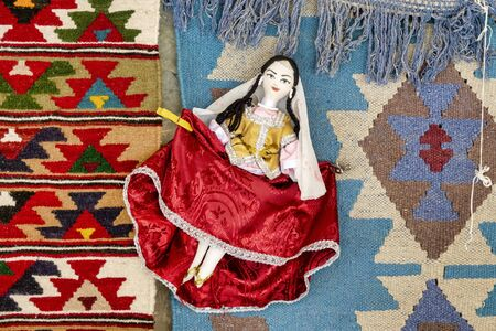 Carpet and doll dressed with traditional azeri dress on display in Lahic, Azerbaijan