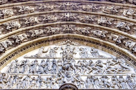 Gothic entrance with reliefs of the Cathedral of Our Lady, Antwerp, Flanders, Belgium