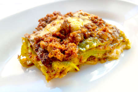 Green lasagne with ragù, Parmesan and bechamel, typical of the bolognese cuisine