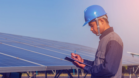 engineer working on checking and maintenance structure and solar panel and find problem to operate at green energy solar power plant Reklamní fotografie