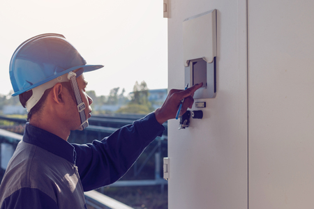 electrician showing thumbs up for great performance energy at solar power plant Stock Photo