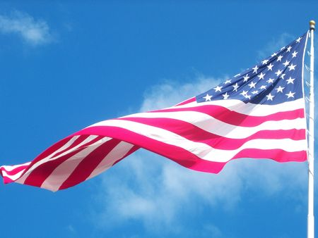 blown: American Flag blown open by a gust of wind on a beautiful day.  Stock Photo