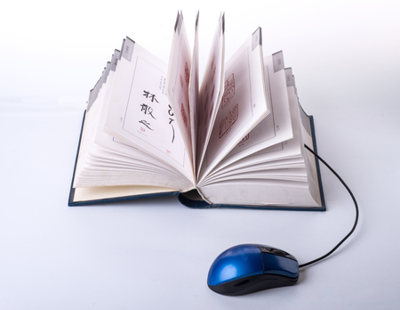 color photo: Color photo with a book and mouse