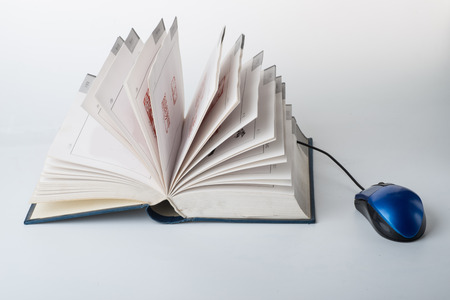 color photo: Color photo of a book and mouse