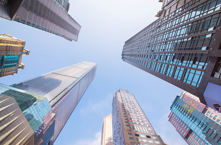 city buildings: Looking up at business buildings in downtown New York, USA