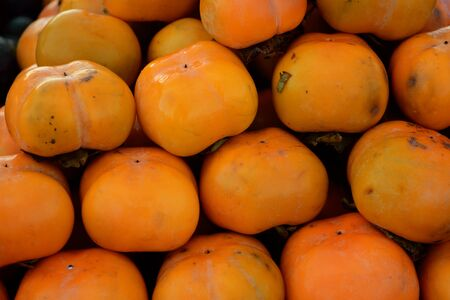 the Persimmon pile for sale at the fresh market in Thailand Фото со стока