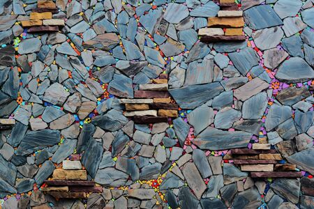 the colorful of old wall made from color stone cladding  at the local home in the northern of Thailand