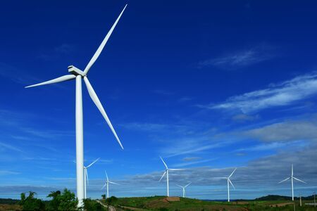 The white electric wind turbine with blue sky on low hill  at Petchaboon,Thailand Stockfoto
