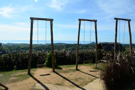 The bamboo swings  with grass flowers and blue sky at tourist attraction of northen Thailand