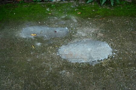 the grey trace  of repaired the holes on cement street