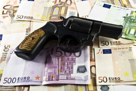 move gun: revolver on a background a money