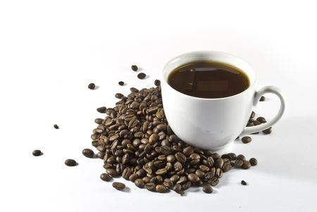 coffeebeans: cup of coffee among coffee-beans on a white background Stock Photo