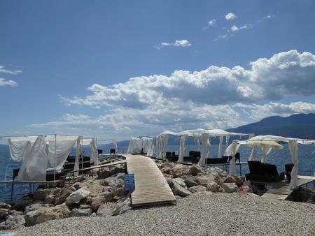 sunshades: Bridge and sunshades on the beach in Rijeka Rijeka, Croatia