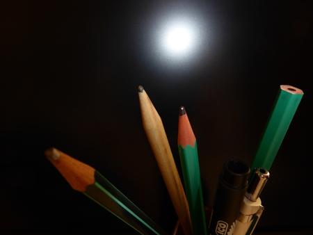 flashing light: Pencils and pens with the flashing light Stock Photo