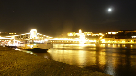historical reflections: View of Budapest with the Danube river at night