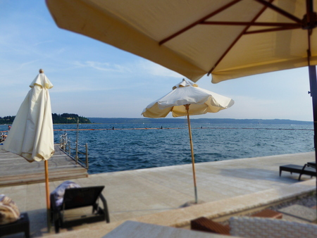 sunshades: View of the Adriatic seashore with sunshades and sunbeds in Portoroz, Slovenia