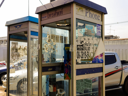 dowdy: NAKHONRATCHASIMA ,THAILAND - FEBRUARY 3 : Thai coin-operated phone booth in the digital age at Nakhonratchasima ,Thailand Editorial