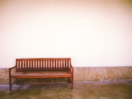 clearly: lonely bench and clearly wall vintage tone