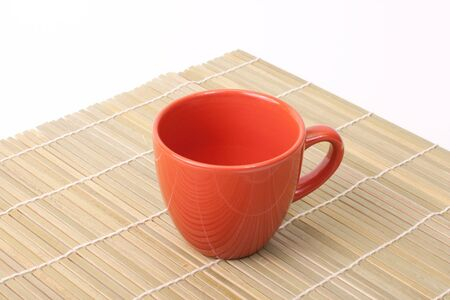 fengshui: Red cup on bamboo corner isolated on white Stock Photo