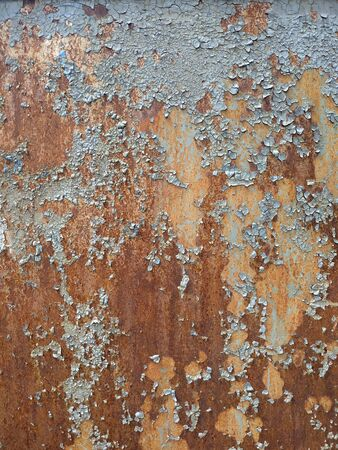 Corroded metal background. Rusted white painted metal wall. Rusty metal background with streaks of rust. Rust stains. The metal surface rusted spots. Rystycorrosion.