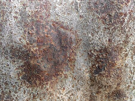 Corroded metal background. Rusty metal background with streaks of rust. Rust stains. Rystycorrosion.