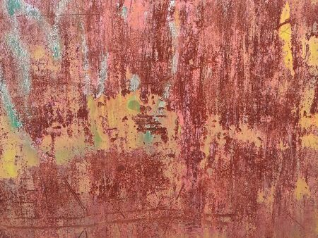 Corroded metal background. Rusted painted metal wall. Rusty metal background with streaks of rust. Rust stains. The metal surface rusted spots. Rystycorrosion. Stock Photo