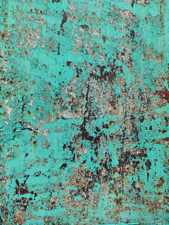 Corroded metal background. Rusted green cyan painted metal wall. Rusty metal background with streaks of rust. Rust stains. The metal surface rusted spots. Rystycorrosion.