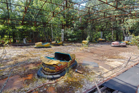 Abandoned Amusement Car Ride in park of attractions in Ghost City of Pripyat in Chernobyl Exclusion Zone, nuclear catastrophe